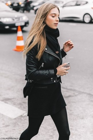 How to wear: black leather biker jacket, black crew-neck sweater, black wool mini skirt, black scarf