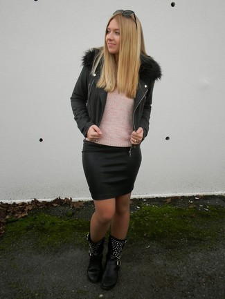 How to wear: black biker jacket, pink crew-neck sweater, black leather mini skirt, black studded leather mid-calf boots