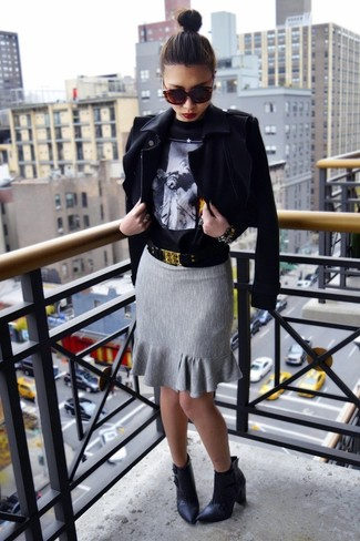 How to wear: black biker jacket, black print crew-neck sweater, grey pencil skirt, black leather ankle boots