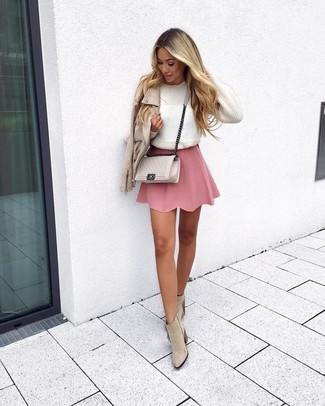 Stay stylish on busy days in a white crew-neck sweater and a pink skater skirt. Add beige fringe suede ankle boots to your ensemble for an instant style upgrade. Longer daylight hours call for cooler ensembles like this one.