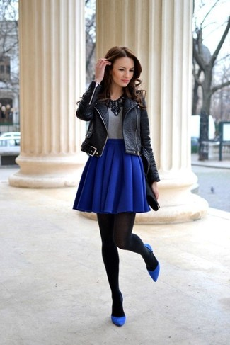 Wear a black leather biker jacket with a dark blue skater skirt for a trendy and easy going look. Navy suede pumps will add a touch of polish to an otherwise low-key look.