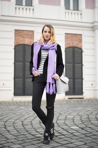 How to wear: black wool biker jacket, grey horizontal striped crew-neck sweater, black ripped skinny jeans, black and white leather low top sneakers