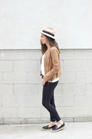 How to wear: tan leather biker jacket, white crew-neck sweater, black skinny jeans, black leather espadrilles