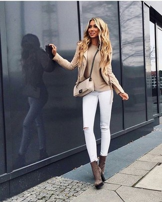 How to wear: beige biker jacket, beige crew-neck sweater, white ripped skinny jeans, brown suede ankle boots