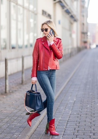 How to wear: red leather biker jacket, pink crew-neck sweater, navy skinny jeans, red leather ankle boots