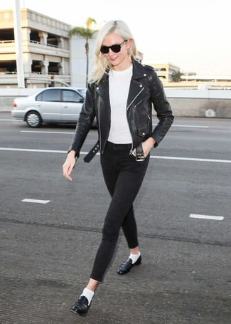 Karlie Kloss wearing Black Leather Biker Jacket, White Crew-neck Sweater, Black Skinny Jeans, Black Leather Loafers