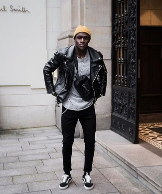 How to wear: black leather biker jacket, grey crew-neck sweater, black skinny jeans, black suede low top sneakers