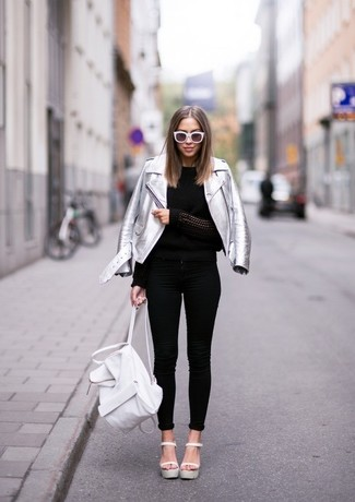 How to wear: silver leather biker jacket, black crew-neck sweater, black skinny jeans, white leather heeled sandals
