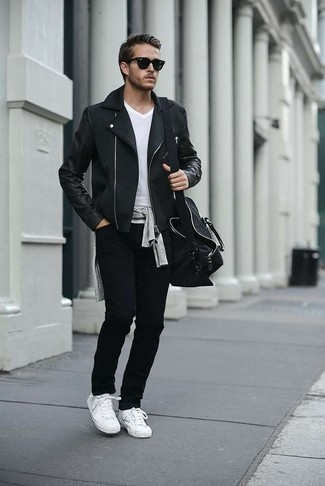 How to Wear Black Jeans For Men: Team a black biker jacket with black jeans to assemble an interesting and modern-looking relaxed casual ensemble. White canvas low top sneakers are a stylish companion for your outfit.