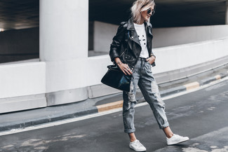 How to wear: black leather biker jacket, white and black print crew-neck t-shirt, grey ripped boyfriend jeans, white leather low top sneakers