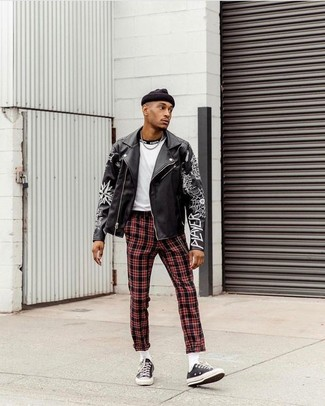 Red Plaid Pants Chill Weather Outfits For Men: This off-duty pairing of a black print leather biker jacket and red plaid pants is extremely easy to pull together in seconds time, helping you look seriously stylish and prepared for anything without spending a ton of time digging through your closet. Black canvas low top sneakers will level up your outfit.