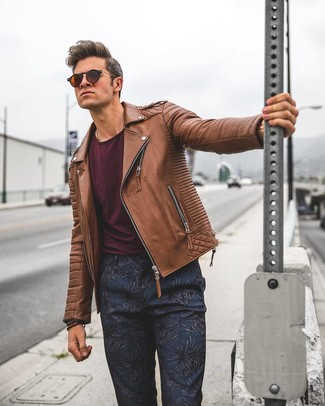 How to wear: brown leather biker jacket, burgundy crew-neck t-shirt, navy floral chinos, dark brown sunglasses
