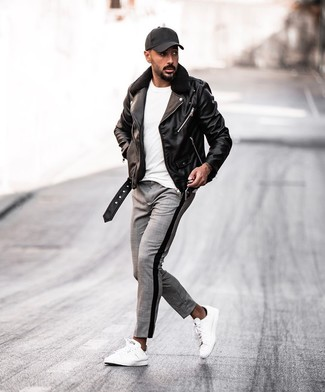 How to wear: black leather biker jacket, white crew-neck t-shirt, grey plaid chinos, white leather low top sneakers