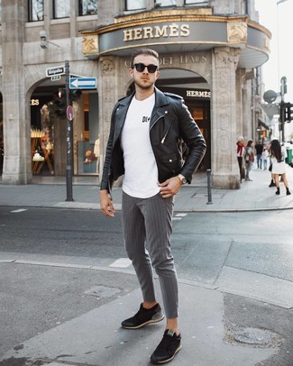 How to wear: black leather biker jacket, white and black print crew-neck t-shirt, grey vertical striped chinos, black low top sneakers
