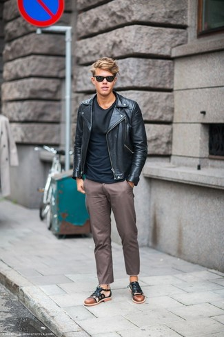 How to Wear Sandals For Men: A black leather biker jacket and brown chinos are a great getup worth incorporating into your daily casual routine. Complete this outfit with a pair of sandals to avoid looking overdressed.
