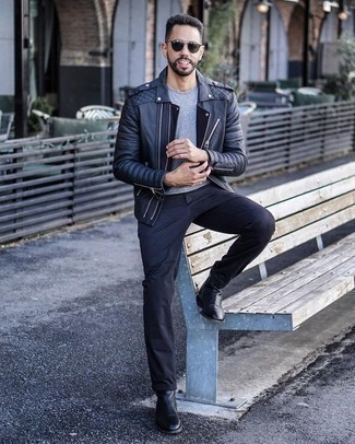 How to Wear Chinos: Extremely dapper and practical, this casual pairing of a black leather biker jacket and chinos brings excellent styling opportunities. Rev up the classiness of your ensemble a bit by wearing black leather chelsea boots.