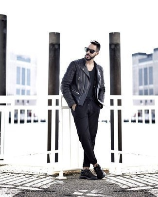 How to Wear a Black Leather Biker Jacket For Men: For effortless style without the need to sacrifice on functionality, we turn to this pairing of a black leather biker jacket and black chinos. Black athletic shoes can instantly dial down an all-too-dressy look.