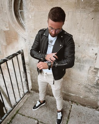 Beige Chinos Outfits: A black quilted leather biker jacket and beige chinos worn together are a wonderful match. If in doubt about the footwear, stick to a pair of black and white leather low top sneakers.