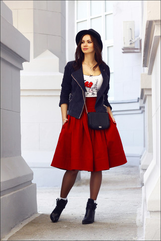 Wear a white and red print crew-neck t-shirt and a red full skirt to create a chic, glamorous look. Perk up your outfit with black leather ankle boots. This combination is absolutely perfect to welcome spring.