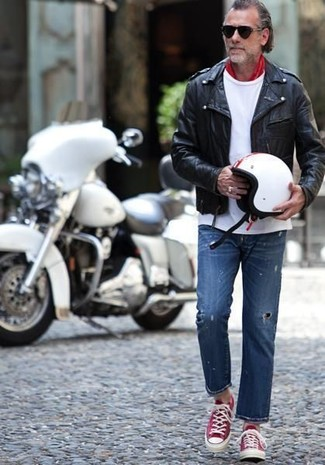 How to wear: black leather biker jacket, white crew-neck t-shirt, blue ripped jeans, red and white low top sneakers