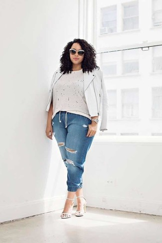 How to Wear Blue Ripped Jeans For Women: A white leather biker jacket and blue ripped jeans are chic items, without which no off-duty closet would be complete. Feeling inventive today? Break up this look by sporting white leather heeled sandals.