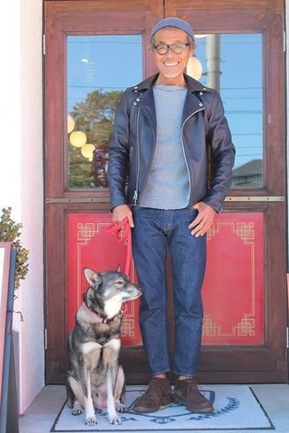 How to wear: navy leather biker jacket, grey crew-neck t-shirt, navy jeans, dark brown suede desert boots