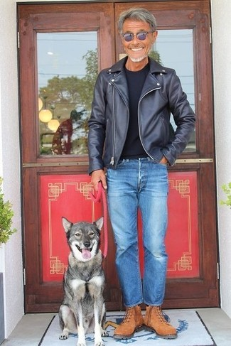 How to wear: black leather biker jacket, black crew-neck t-shirt, blue jeans, brown suede work boots