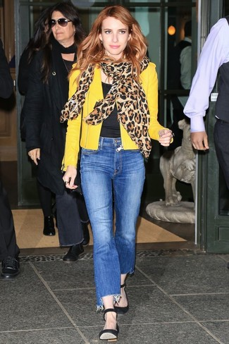 How to wear: yellow leather biker jacket, black crew-neck t-shirt, blue jeans, black suede pumps