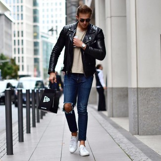 How to Wear White Leather Low Top Sneakers In Chill Weather In a Relaxed Way For Men: Rock a black leather biker jacket with navy ripped jeans for a trendy and contemporary getup. White leather low top sneakers are guaranteed to inject an extra touch of style into your look.