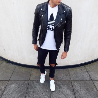 How to Wear White Leather Low Top Sneakers In Chill Weather In a Relaxed Way For Men: A black leather biker jacket and black ripped jeans will convey a casual-cool vibe. Here's how to level up this outfit: white leather low top sneakers.