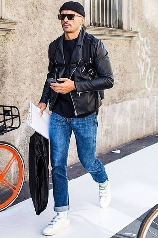 How to Wear a Black Leather Biker Jacket For Men: When comfort is top priority, this combination of a black leather biker jacket and blue jeans is a no-brainer. Look at how great this outfit is rounded off with a pair of white leather low top sneakers.