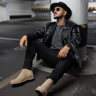 Black Jeans Outfits For Men: Go for a pared down yet cool and casual option in a black leather biker jacket and black jeans. Complete this getup with beige suede chelsea boots to easily kick up the classy factor of any outfit.