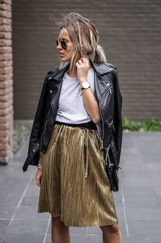 Gold Mini Skirt Outfits: Demonstrate your outfit coordination chops by wearing this laid-back combination of a black leather biker jacket and a gold mini skirt.