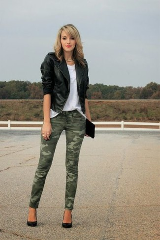 How to wear: black leather biker jacket, white crew-neck t-shirt, olive camouflage skinny jeans, black satin pumps