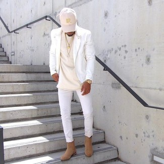How to wear: white leather biker jacket, beige crew-neck t-shirt, white skinny jeans, tan suede chelsea boots
