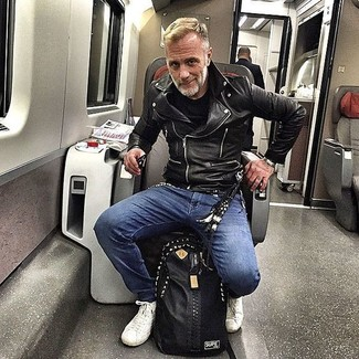 How to Wear White Leather High Top Sneakers For Men: If you're hunting for a modern casual and at the same time dapper getup, rock a black leather biker jacket with blue skinny jeans. Introduce white leather high top sneakers to your look and off you go looking spectacular.