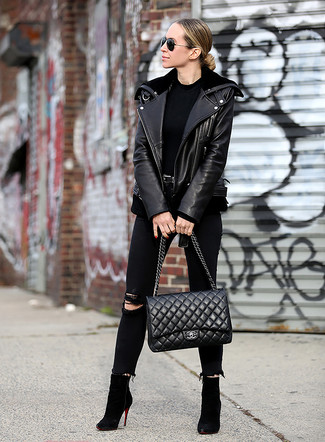 Black Ripped Skinny Jeans Outfits: This laid-back combo of a black leather biker jacket and black ripped skinny jeans is a real lifesaver when you need to look chic but have zero time to assemble a look. Want to go all out in the shoe department? Complement your ensemble with black suede ankle boots.