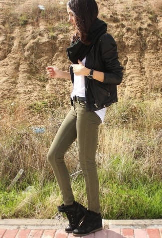 How to wear: black leather biker jacket, white crew-neck t-shirt, olive skinny jeans, black suede wedge sneakers