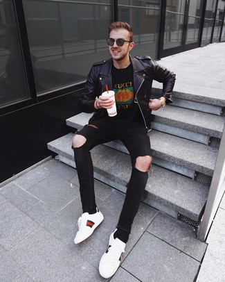 How to wear: black leather biker jacket, black print crew-neck t-shirt, black ripped skinny jeans, white print leather low top sneakers