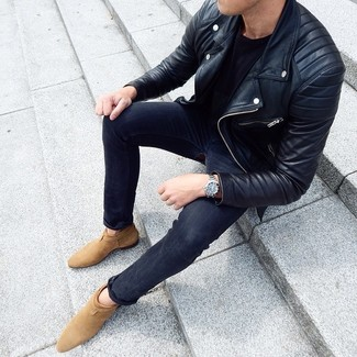 How to Wear Charcoal Skinny Jeans For Men: A black leather biker jacket and charcoal skinny jeans are an easy way to introduce extra cool into your casual lineup. To give your overall ensemble a more sophisticated vibe, complement your getup with a pair of tan suede chelsea boots.