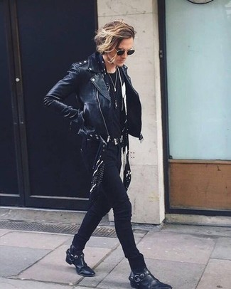 How to Wear a Black Leather Biker Jacket For Men: A black leather biker jacket and black skinny jeans make for the ultimate casual style for today's guy. Put a more relaxed spin on your ensemble by wearing black leather cowboy boots.