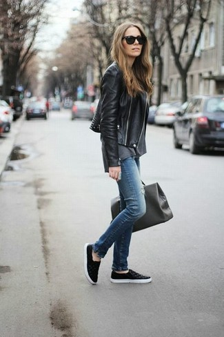 Choose a black leather moto jacket and blue destroyed slim jeans for a refined yet off-duty ensemble. Black leather slip-on sneakers are the right shoes here to get you noticed.