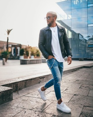 Black Leather Jacket with Blue Pants Outfits For Men: Marry a black leather jacket with blue pants for relaxed dressing with an edgy spin. To add a bit of fanciness to your look, complete your outfit with white canvas low top sneakers.