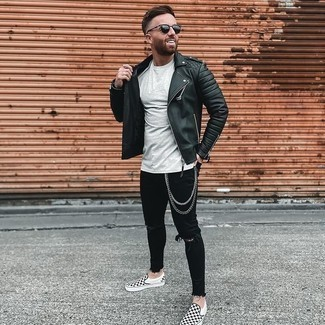 Black Quilted Leather Biker Jacket Outfits For Men: A black quilted leather biker jacket and black ripped skinny jeans are ideal as an ensemble for weekend days. A trendy pair of black and white check canvas slip-on sneakers is an easy way to transform your outfit.