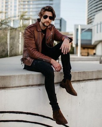 Dark Brown Suede Chelsea Boots Outfits For Men: This combination of a brown leather biker jacket and black ripped skinny jeans sends off a laid-back and approachable kind of vibe. Dark brown suede chelsea boots will add an elegant twist to an otherwise all-too-common getup.