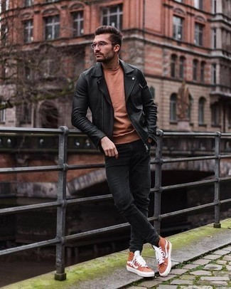 Black Skinny Jeans with Black Leather Biker Jacket Outfits For Men: This combination of a black leather biker jacket and black skinny jeans delivers comfort and practicality and helps you keep it simple yet trendy. Round off with a pair of orange canvas high top sneakers and ta-da: your look is complete.