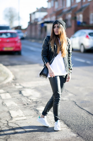 This combo of a black leather moto jacket and a black beanie gives off a very casual and approachable vibe. A pair of white athletic shoes will be a stylish addition to your look. A vivid example of transitional fashion, this look is an essential this spring.