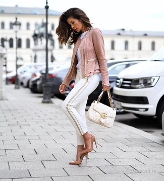 How to Wear Tan Leather Pumps: A pink leather biker jacket and white skinny pants are a good look to have in your arsenal. You could perhaps get a bit experimental on the shoe front and add tan leather pumps to the mix.