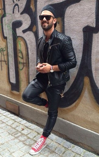 How to Wear Black Sweatpants For Men: Rock a black quilted leather biker jacket with black sweatpants to feel infinitely confident and look stylish. Our favorite of a multitude of ways to complement this outfit is a pair of red high top sneakers.