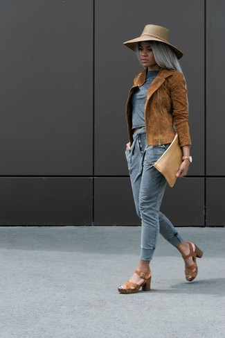 How to wear: tobacco suede biker jacket, grey crew-neck t-shirt, grey sweatpants, brown leather heeled sandals